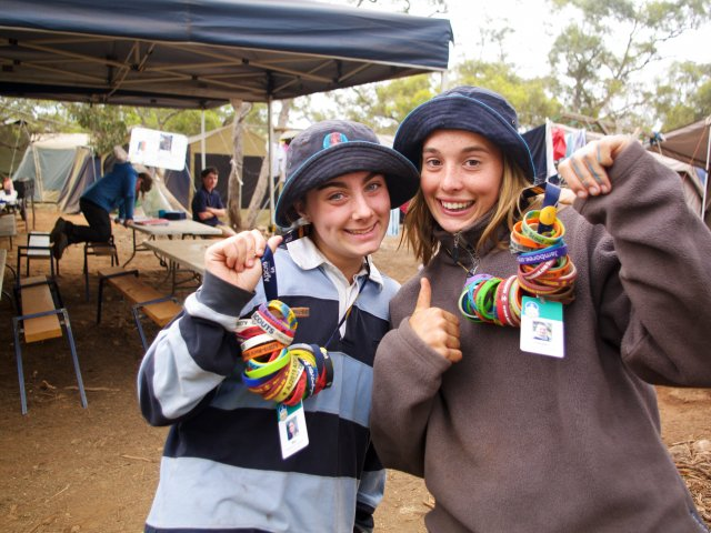 Two Female Scouts AJ2019 Showing Wristbands LBPS Call to Action