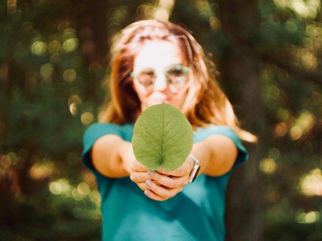Sustainability Strategy Woman Holding Leaf