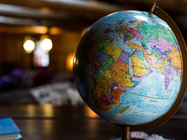 Our Worldwide Family World Map Globe Graphic
