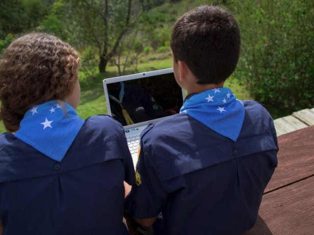 Program conference Two Scouts Sitting Watching Laptop