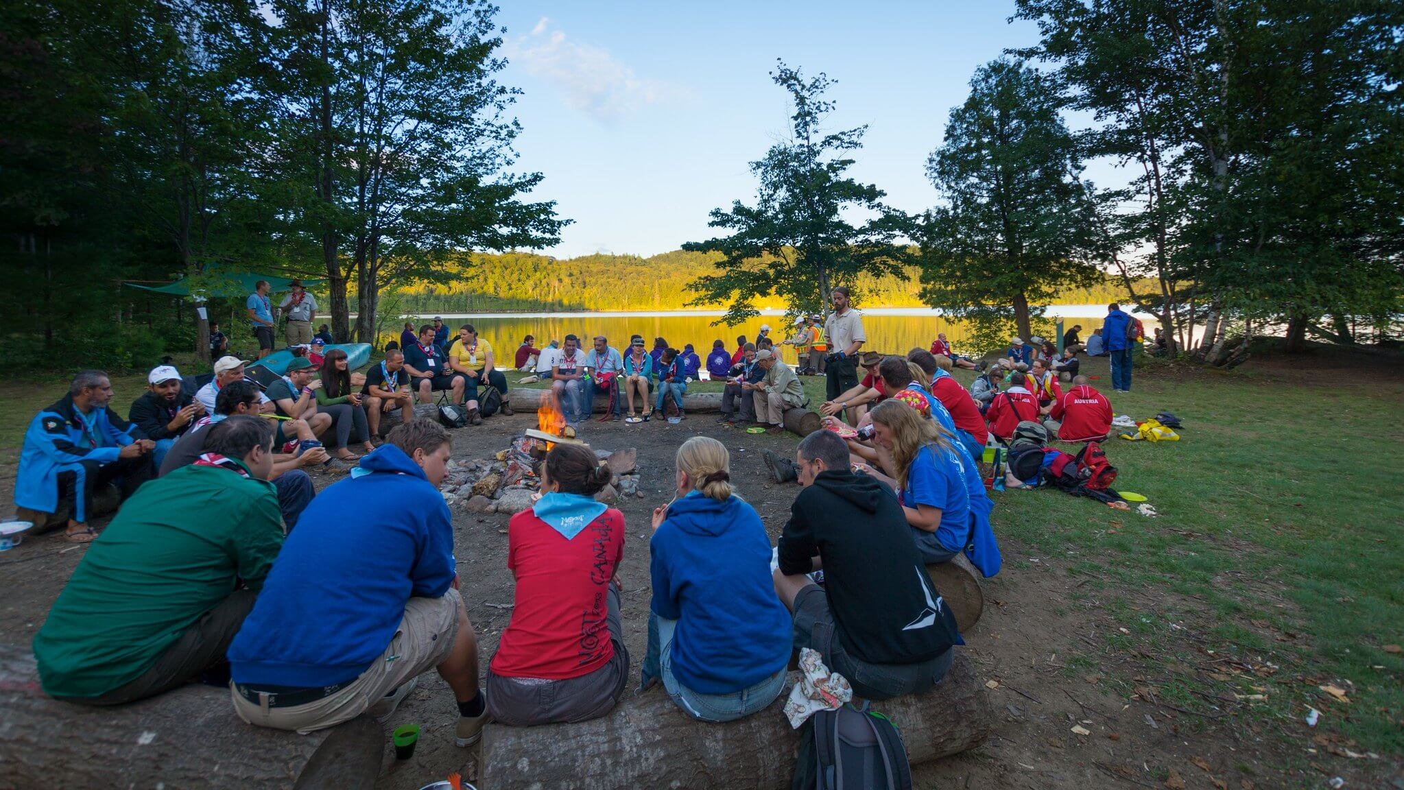 WOSM's Action on Envionrmental Sustainability Scouts Around Campfire